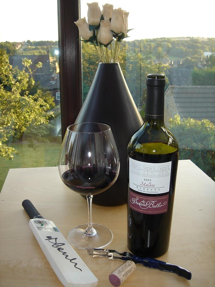 Susana Balbo Malbec next to a cricket bat signed by Phil Tuffnell (for some reason)