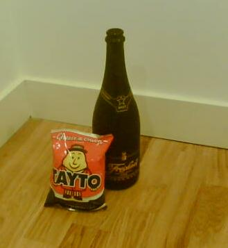 A bottle of Freixenet next to my all time favourite Irish Tayto Crisps (for some reason)