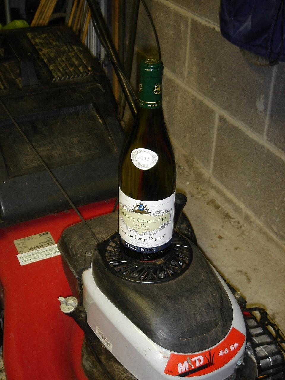 Don't try this at home - a Grand Cru Chablis balancing precariously on my lawn mower (for some reason)