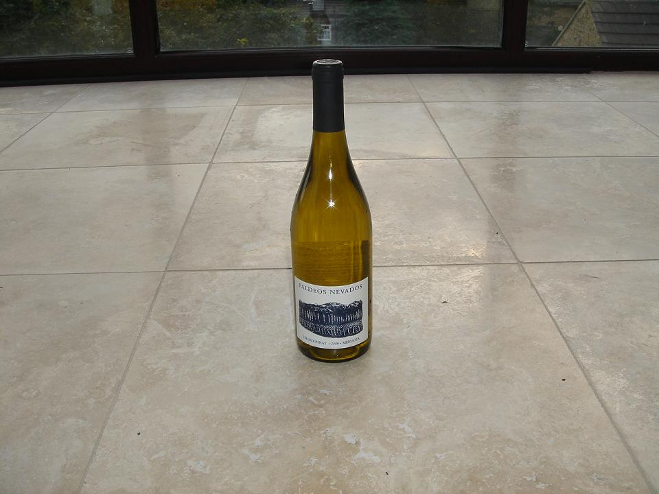 My beautiful travertine floor (about to get ripped out) and a bottle of Faldeos Chardonnay (for some reason)