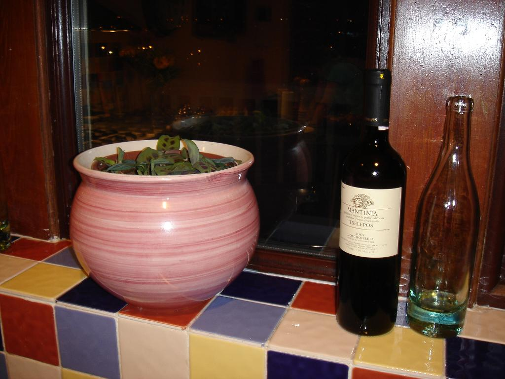 Mantinia (75cl) next to a Pot Lyonnais (46cl) and a plant…for some reason